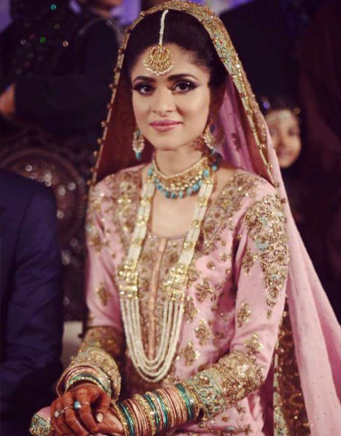Our very own beauty Arij Fatima served a perfect inspiration for Valima look on her own reception. Dolled up in baby pink and gold tones; gives a regal touch to the attire.