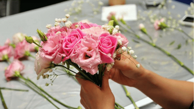 flowers with wedding invitations